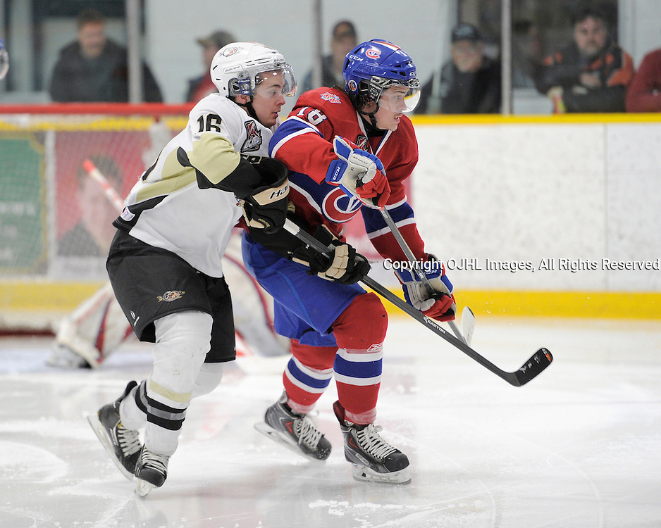 TRENTON, ON - Mar 18 : OJHL North East Conference playoff series round two, Kingston Voyageurs vs Trenton Golden Hawks, Dylan Savory #16 and Wyatt Cota #18 race for the puck during second period game action<br /> (Photo by Amy Deroche / OJHL Images)