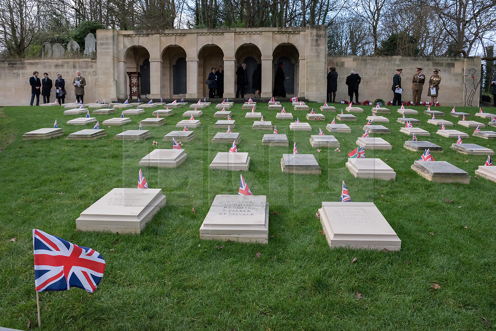© Licensed to London News Pictures. 08/12/2018. Bristol, UK. Special ceremony at Arnos Vale Cemetery, Bristol, to mark the completion of the Commonwealth War Graves Commission's (CWGC) restoration work to preserve grave markers and memorials to the war dead. The Commonwealth War Graves Commission replaced and restored grave markers and memorials to First World War heroes in its biggest UK restoration project of 2018. The Soldiers' Corner plot at the cemetery had fallen into disrepair due to the neglect of the cemetery in the 80s and 90s under a previous owner. Some of the original grave markers had been removed or were in poor condition. When the Arnos Vale Cemetery Trust took over the site after a local campaign, the stones were put back on the memorial with the help of the local army reserves. Invited guests included the descendants of some of the war heroes buried in the cemetery. Among those replaced was the grave marker of Private William Walker of the 6th Australian Infantry, who died in Bristol on 11 December 1918. A new exhibition also launches telling the story of CWGC, its global reach and the personal stories of some of those from around the world remembered at Arnos Vale Photo credit: Simon Chapman/LNP