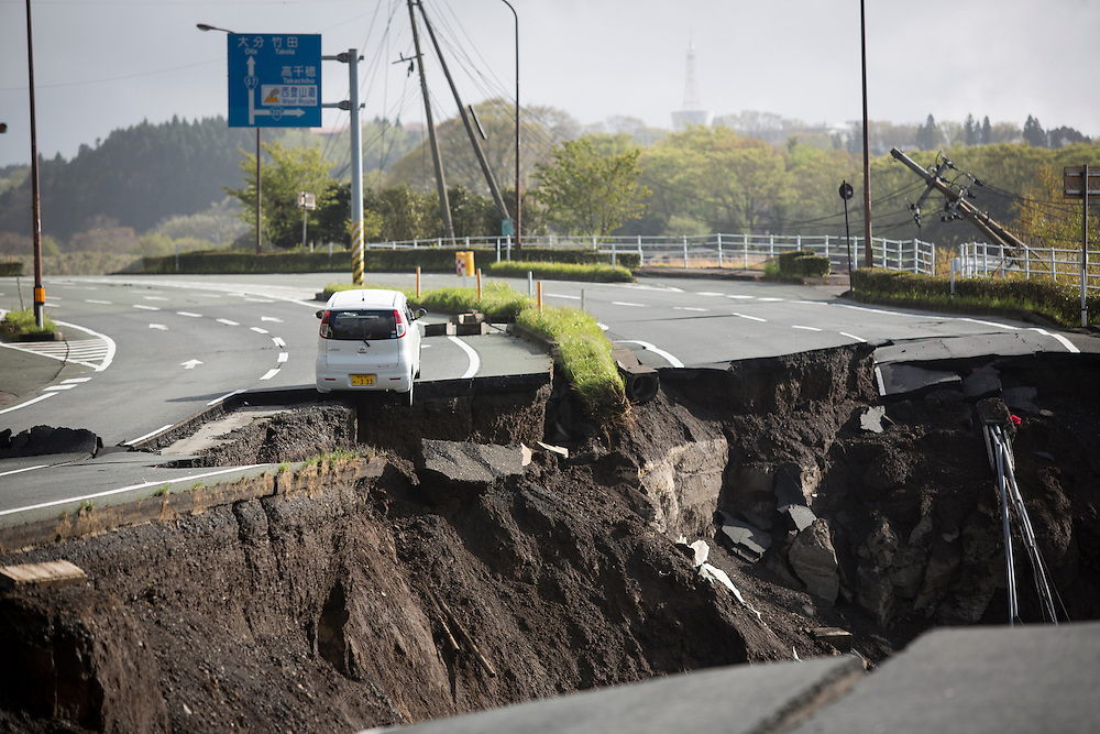 KUMAMOTO, JAPAN - APRIL 17: A vehicle was suspended in the middle highway after a landslide cause by a a magnitude-7.3 quake Sunday morning of April 17, 2016 in Minami Aso, Kumamoto prefecture, Japan. <br />