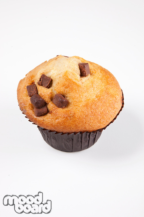 Freshly baked muffin over white background
