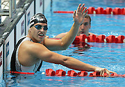 New Zealand's Moss Burmester celebrates winning a Bronze medal in the Mens 100m Butterfly Swimming Final at the XVIII Commonwealth Games, Melbourne, Australia, Monday, March 20 2006. Photo: Michael Bradley/PHOTOSPORT<br /><br />150611 celebration celebrating swimmer