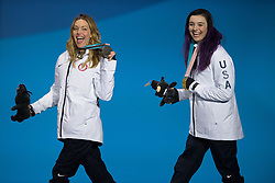 March 12, 2018 - Pyeongchang, South Korea - Gold medalist Brenna Huckaby of the US, right, and teammate Amy Purdy (silver) celebrate during a medal ceremony for Women's Snowboard Cross Monday, March 12, 2018 at the Medals Plaza for the 2018 Pyeongchang Winter Paralympic Games. Photo by Mark Reis (Credit Image: © Mark Reis via ZUMA Wire)