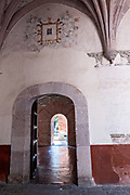 Interior hallway with painted mural at the San Nicolas Tolentino Temple and Ex-Monastery in Actopan, Hidalgo, Mexico. The colonial church and convent  was built in 1546 and combine architectural elements from the romantic, gothic and renaissance periods.