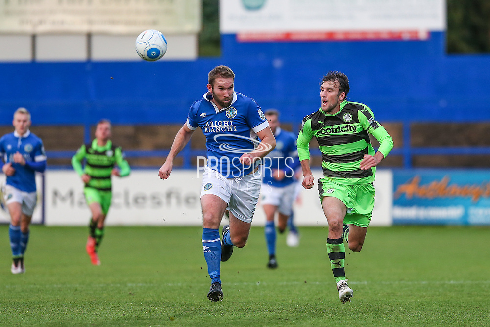 Forest Green Rovers Christian Doidge(9) and Macclesfield's John McCombe race for the ball during the Vanarama National League match between Macclesfield Town and Forest Green Rovers at Moss Rose, Macclesfield, United Kingdom on 12 November 2016. Photo by Shane Healey.