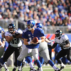 Quarterback Eli Manning #10 of the New York Giants tosses the ball during NFL football action between the New York Giants and Jacksonville Jaguars on Nov. 28, 2010 at MetLife Stadium in East Rutherford, N.J.
