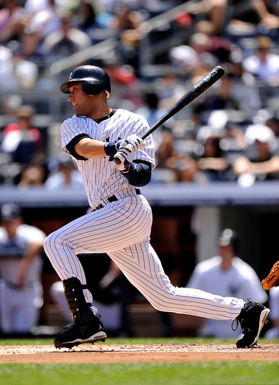 NEW YORK - MAY 15: Derek Jeter # 2 of the New York Yankees bats against the Minnesota Twins at Yankee Stadium on May 15, 2010 in the Bronx borough of Manhattan. The Yankees defeated the wins 7 to 1. (Photo by Rob Tringali) *** Local Caption ***  Derek Jeter