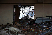 A car lies among the debris strewn across the floor of the sports center where Hideharu Sasaki was almost drowned following the March 11 tsunami in Rikuzebtakata, Iwate Prefecture, Japan on 09 March 2012. Around 100 people died in the sports center, while 4 people survived. Photographer: Robert Gilhooly