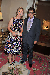 NICKY & JUNITA KERMAN at Ambassador Earle Mack's 60's reunion party held at The Ritz Hotel, London on 18th June 2012.