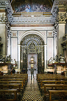 NAPLES, ITALY - 20 DECEMBER 2017: Visitors are seen here in the Royal Chapel of the Treasure of St. Januarius, or the Reale cappella del Tesoro di San Gennaro, located in the Cathedral of Naples, Italy, and dedicated to St. Januarius, patron saint of the city, in Naples, Italy, on December 20th 2017.<br /> <br /> Januarius, who lived between the 3rd and 5th century AD, is the patron saint of Naples, where the faithful gather three times a year in Naples Cathedral to witness the liquefaction of what is claimed to be a sample of his blood kept in a sealed glass ampoule.