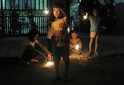 Image licensed to i-Images Picture Agency. 27/07/2014. Kedah,Malaysia. this picture taken July 27, 2014. Children play with they fireworks to celebrate last day of the Muslim holy fasting month of Ramadan. Picture by Mohd Firdaus / i-Images