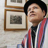 Demingo Cuatindioy with his pieces 'Grinding Stone' and 'Grandmother With Firewood' at the Clare Printmakers exhibition in the Russell Gallery in New Quay on Saturday evening.<br /> <br /> Photograph by Yvonne Vaughan.