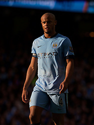 MANCHESTER, ENGLAND - Sunday, November 2, 2014: Manchester City's captain Vincent Kompany in action against Manchester United during the Premier League match at the City of Manchester Stadium. (Pic by David Rawcliffe/Propaganda)