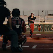 Monica Abbott, 14, takes her first pitch against the Dallas Charge. The Scrap Yard Dawgs won the game 1-0.<br /> <br /> Todd Spoth for The New York Times.