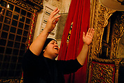 Old City, Christian Syriac churc of St Marks. This woman is praying in Aramaic, the ancient language of Levant at Jesus times. For the Syrian Church the basement' s room is is the St Mark's house and the Last Supper place.
