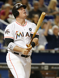 May 12, 2017 - Miami, FL, USA - Miami Marlins first baseman Justin Bour (41) hits a home run in the fourth inning against the Atlanta Braves on Friday, May 12, 2017 in Miami, Fla. (Credit Image: © Al Diaz/TNS via ZUMA Wire)
