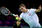Jerzy Janowicz of Poland competes in single match during the BNP Paribas Davis Cup 2014 between Poland and Croatia at Torwar Hall in Warsaw on April 4, 2014.<br /> <br /> Poland, Warsaw, April 4, 2014<br /> <br /> Picture also available in RAW (NEF) or TIFF format on special request.<br /> <br /> For editorial use only. Any commercial or promotional use requires permission.<br /> <br /> Mandatory credit:<br /> Photo by &copy; Adam Nurkiewicz / Mediasport