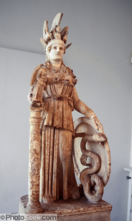 "In the National Archaeological Museum in Athens, Greece, see a Roman model of the ""Athena Polias"" (""Athena of the city"") sculpture which was placed in the Parthenon in 432 BC, originally 12 meters high. Athena (Athene or Athina) has Nike in her right hand, and sphinx and griffins in her headpiece. Greeks built the Parthenon atop the Acropolis in 447-438 BCE as a place to worship goddess Athena and also as a treasury to store tribute money moved from Delos Island. The Greek philosopher, Plato (429347 BC), identified Athena with the Libyan deity Neith who was the war goddess and huntress deity of the Egyptians since the ancient Pre-Dynastic period, and who was also identified with weaving. Athena is the virgin patron of her namesake city Athens, and is goddess of wisdom, courage, inspiration, civilization, law and justice, just warfare, mathematics, strength, strategy, the arts, crafts, and skill. Minerva, Athena's Roman incarnation, embodies similar attributes."