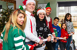 Christmas crackers are puled as the 'family' gets into the swing of Christmas. Left - right Barby, Mike, Miriam, Lee, Charlie, Sofia and Florencia. Brighton, December 16 2018.