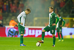 BRUSSELS, BELGIUM - Tuesday, October 15, 2013: Wales' captain Aaron Ramsey and Simon Church look dejected as Belgium score the opening goal during the 2014 FIFA World Cup Brazil Qualifying Group A match at the Koning Boudewijnstadion. (Pic by David Rawcliffe/Propaganda)
