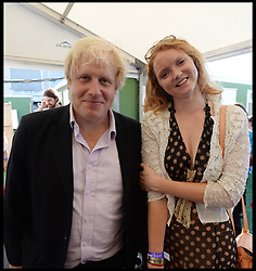 Boris Johnson with Model Lilly Cole backstage at the Celebration of the 2012 Olympic Games volunteering one year on at the  Queen Elizabeth Olympic Park.<br /> Mayor of London Boris Johnson and Lord Coe will be taking to the stage at Go Local to encourage a new drive in volunteering one year on from the Games. Also present are multi-platinum selling pop rock band McFly; world famous comedian Eddie Izzard, Brit Award nominated The Feeling, and Britain'Got Talent winners Attraction, in addition to stars Jack Carroll and Gabz. The event will be the UKs biggest ever celebration of volunteering and first Olympic and Paralympic legacy event at Queen Elizabeth Olympic Park.<br /> London, United Kingdom<br /> Friday, 19th July 2013<br /> Picture by Andrew Parsons / i-Images