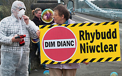 People against Wylfa B protest by the Menai Suspension Bridge Anglesey<br /> on March 11th 2012 the first anniversary of the Fukushima disaster with the support of CND Cymru Welsh Language Society Greenpeace and Bangor and Ynys Mon peace group