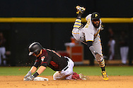 Apr 23, 2016; Phoenix, AZ, USA; Pittsburgh Pirates infielder Josh Harrison (5) attempts to turn two over the sliding Arizona Diamondbacks shortstop Nick Ahmed (13) at Chase Field. The Arizona Diamondbacks won 7-1. Mandatory Credit: Jennifer Stewart-USA TODAY Sports