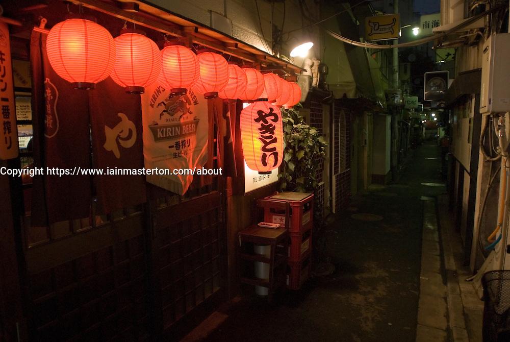 Night view of small bar in Golden Gai district of Shinjuku in Tokyo Japan