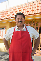 Portrait of restaurant owner, outdoors