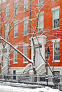 Washington Square North in Greenwich Village, Manhattan, New York City, during winter snowstorm, showing Greek Revival Row Houses.