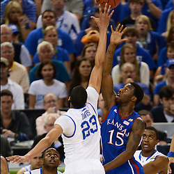 Apr 2, 2012; New Orleans, LA, USA; Kansas Jayhawks guard Elijah Johnson (15) shoots as Kentucky Wildcats forward Anthony Davis (23) defends during the first half in the finals of the 2012 NCAA men's basketball Final Four at the Mercedes-Benz Superdome. Mandatory Credit: Derick E. Hingle-US PRESSWIRE