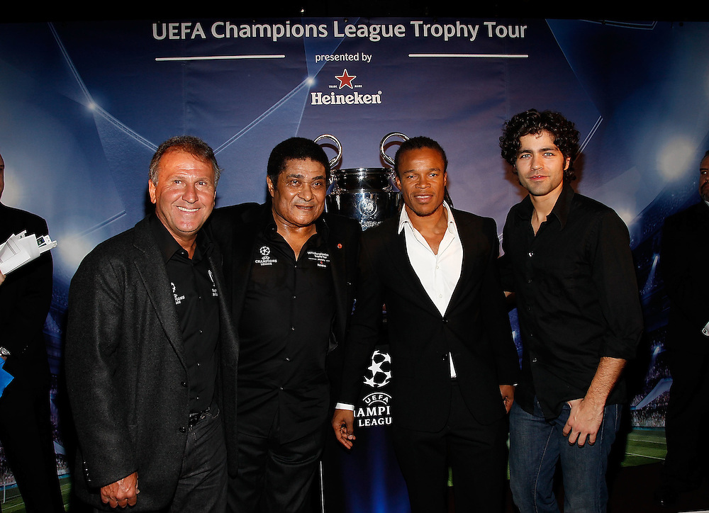 NEW YORK - FEBRUARY 17:  (L-R) Athletes Zico, Eusebio, Edgar Davids and actor Adrian Grenier attend the Heineken Brings UEFA Champions League Trophy to the US event at 230 Fifth Avenue on February 17, 2010 in New York City.  (Photo by Joe Kohen/Getty Images for Heineken)
