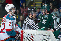 KELOWNA, CANADA - DECEMBER 30:  MacKenzie Johnston #22 of the Kelowna Rockets exchanges words with Carson Stadnyk #16 of Everett Silvertips at the Kelowna Rockets on December 30, 2012 at Prospera Place in Kelowna, British Columbia, Canada (Photo by Marissa Baecker/Shoot the Breeze) *** Local Caption ***