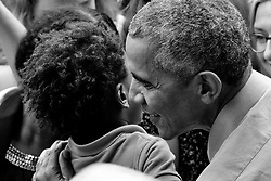 Isaiah Mandela receives a hug from  former President Barack Obama at a political rally in support of the re-election of Governor Tom Wolf and Senator Bob Casey, at the Dell.<br /> <br /> NOTE FOR EDITOR: <br /> CONTACT: 215.356.7333 dawn@chavousconsulting.com