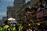 June 18, 2011, Boston, MA - Police watched as the home town sports heros passed by. Photo by Lathan Goumas