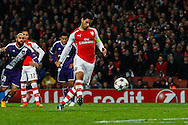 Mikel Arteta of Arsenal scores his team's first goal, from the penalty spot, against R.S.C Anderlecht during the UEFA Champions League match at the Emirates Stadium, London<br /> Picture by David Horn/Focus Images Ltd +44 7545 970036<br /> 04/11/2014