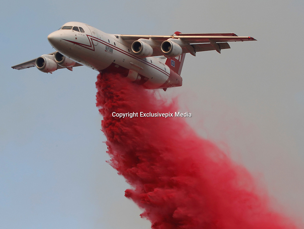 June 20, 2016 - Duarte, California, U.S. -A tanker drops fire retardant as a wildfire burns along Highway 94 near Potrero on Monday.<br /> &copy;Exclusivepix Media