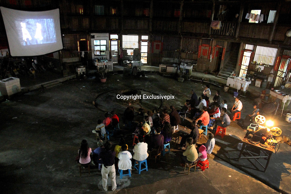 """ZHANGZHOU, CHINA - (CHINA OUT) <br /> <br /> """"Movie Theater"""" In Rural China <br /> <br /> Movie projectionist Qiu Wensheng shows a movie for villagers in Zhangzhou, Fujian Province of China. There are many movie projectionists working in rural areas to show movies for farmers. <br /> ©Exclusivepix"""