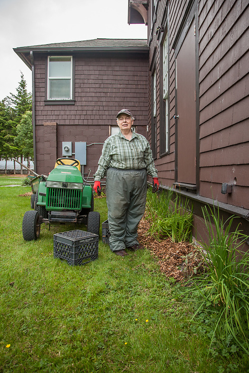 Part time landscaper and volunteer Gail E. Ferris on the campus of the Sitka Fine Arts Camp.
