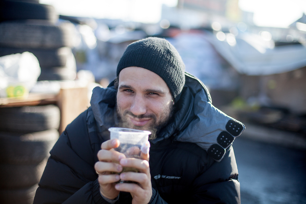 "Spiegel writer Takis Würger having a tea at the barrikades blocking a building supplies store named ""Epicenter"" in the city of Lviv, Ukraine."