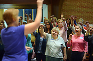HOLLAND, PA -  SEPTEMBER 16:  Pat Guth (left) of Holland, Pennsylvania leads as Joann Cosgrove (center) of Levittown, Pennsylvania and Linda Strasburg (right) of Doylestown, Pennsylvania the newly formed women's chorus group at Trinity Church rehearse September 16, 2013 in Holland, Pennsylvania. (Photo by William Thomas Cain/Cain Images for the Courier Times)