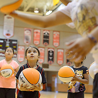 060314       Cayla Nimmo<br /> <br /> Amari Vargas practices dribbling and passing during basketball camp Tuesday morning at Gallup High School.