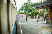 07 JANUARY 2013 - KANCHANABURI, THAILAND:  A train comes to a stop at a station on the line between Bangkok Noi (Thonburi station) and Kanchanaburi.  Thailand has a very advanced rail system and trains reach all parts of the country.    PHOTO BY JACK KURTZ