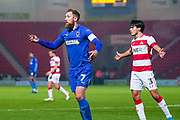 AFC Wimbledon midfielder Scott Wagstaff (7) reacts during the The FA Cup match between Doncaster Rovers and AFC Wimbledon at the Keepmoat Stadium, Doncaster, England on 19 November 2019.