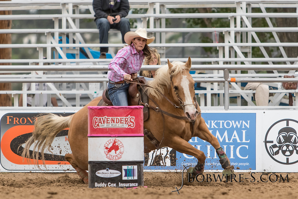 Jennifer Hiler makes her barrel racing run during slack at the Elizabeth Stampede on Sunday, June 3, 2018.