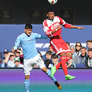 Teal Bunbury, (right), New England Revolution, is challenged by Diego Martínez , NYCFC, during the New York City FC Vs New England Revolution, MSL regular season football match at Yankee Stadium, The Bronx, New York,  USA. 26th March 2016. Photo Tim Clayton