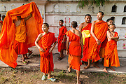 28 JUNE 2014 - DAN SAI, LOEI, THAILAND:  Buddhist novices at Wat Ponchai watch the rocket launches during the Ghost Festival in Dan Sai. Phi Ta Khon (also spelled Pee Ta Khon) is the Ghost Festival. Over three days, the town's residents invite protection from Phra U-pakut, the spirit that lives in the Mun River, which runs through Dan Sai. People in the town and surrounding villages wear costumes made of patchwork and ornate masks and are thought be ghosts who were awoken from the dead when Vessantra Jataka (one of the Buddhas) came out of the forest.    PHOTO BY JACK KURTZ