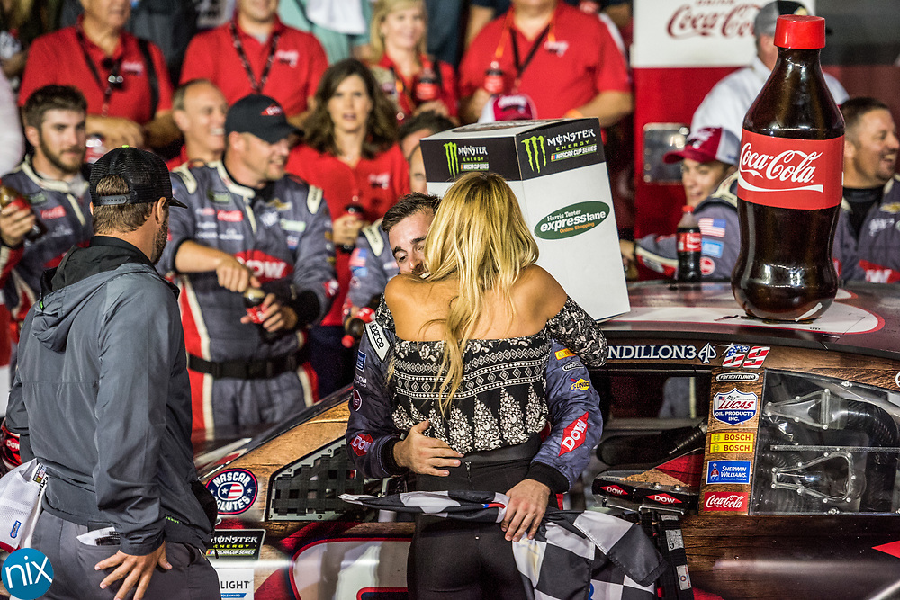 Austin Dillon hugs his finance Whitney Ward while  celebrating winning the Coca-Cola 600 at Charlotte Motor Speedway Sunday, May 28, 2017.