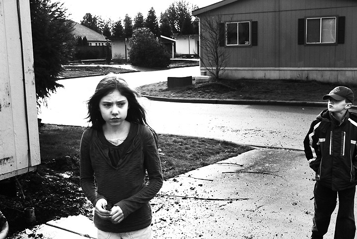 Holding a piece of the tree her family planted outside their home, Sadie Stull and her brother Tyler take a look around the now-empty neighborhood where they grew up. When the owner of Keizer's Berkshire Estates mobile home park decided to redevelop for single-family homes, the Stulls and other families had to move. The Stulls wound up declaring bankruptcy when they were unable to afford moving their home. A package of bills is in discussion in the Legislature to help mobile home owners when the landlords want to sell.