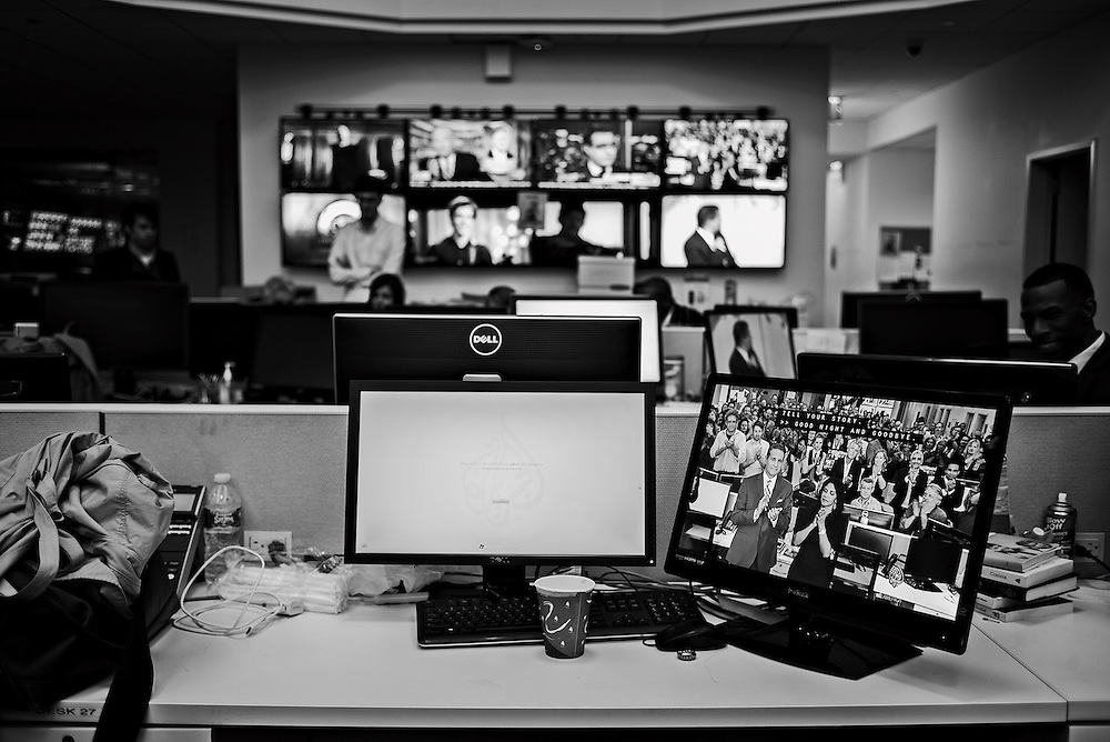 Antonio Mora and Richelle Carey deliver Al Jazeera America's final sign-off, as seen on a newsroom monitor, New York, NY, US