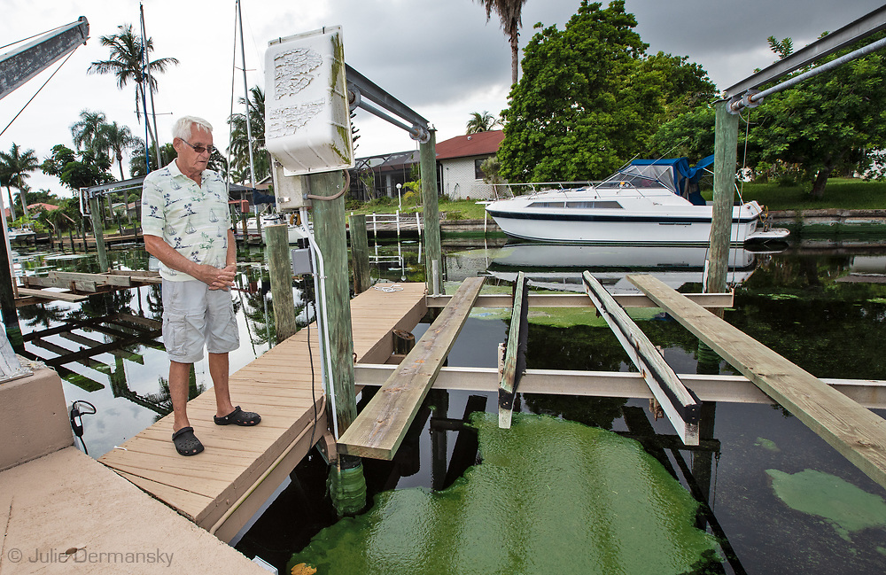 Roger Armstrong bought a house near the yatch club in Cape Coral in 2013, and now regrets it due to the blue-green algae blooms that are in the canals near his home.